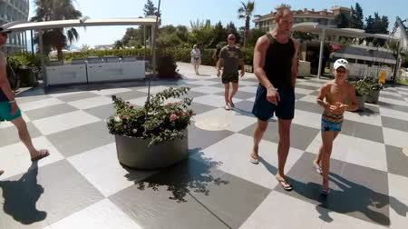 Hyperlapse footage of young man waking up in hotel room and walking to the sea beach. Male tourist on summer vacation