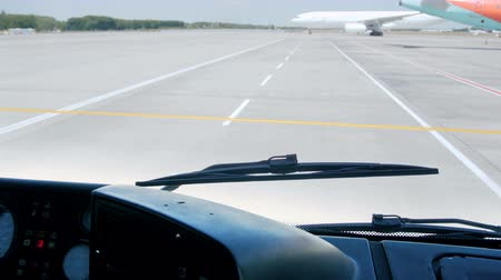 inside bus : 4k video from inside of passenger bus of riding on aircraft runway at international airport