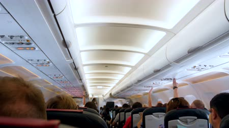 бортовой : 4k out of focus video of long row of passenger seat in airplane before take off