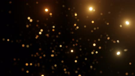 Abstract motion background shining gold particles. Shimmering Glittering Particles With Bokeh. Seamless 4K loop video Stock Footage