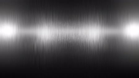 Stainless steel titanium metal background texture. Incident light on the texture of the metal. Lightening and darkening of metal.