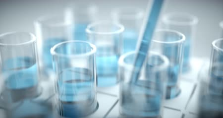 Test tubes filled with blue chemistry, science concept and laboratory. Wideo