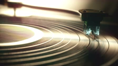 gramophone : Vinyl record being played on old retro vintage disc jockey device.