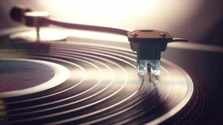 Vinyl record being played on old retro vintage disc jockey device.