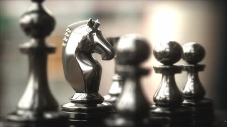 dois objetos : The Knight in highlight. Pieces of chess game, image with shallow depth of field. Stock Footage