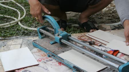çini : Worker cutting tile with tile cutter