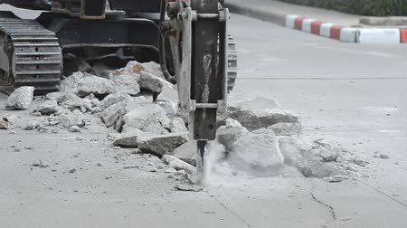 destroyer : Excavator breaking concrete road surface with hydrohammer drill at repairing roadwork