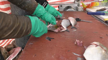 cleaning products : A fish shop. The process of cleaning fish.
