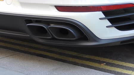 escape : An exhaust pipe in the rear of the cars.
