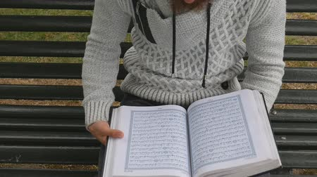 kultúra : A man is reading Quran. A Muslim in Ramadan.