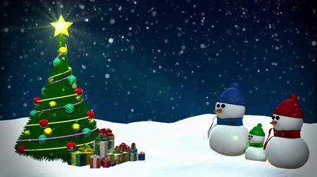 sniezynka : Snowmen at winter snowfall background