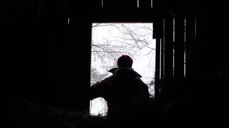 poddasze : Winter Girl in the attic of an old village house. Loneliness and cold. Escape from civilization Wideo