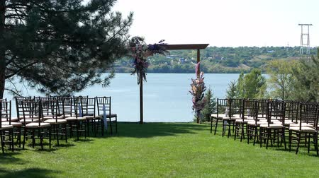 Venue of the wedding ceremony. Wedding arch on a green lawn with stunning river views
