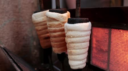 Czech trdelnik is baked in a special oven Stock Footage