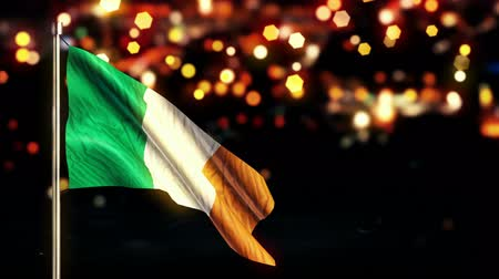 irlandia : Ireland National Flag City Light Night Bokeh Loop Animation - 4K Resolution Ultra HD UHD Wideo