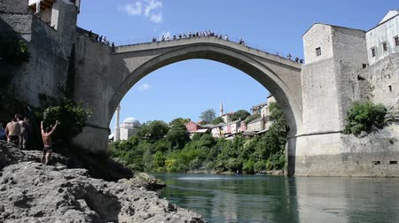 herzegovina : A man diving on the old brigde in Mostar, Bosnia , Bosnia and Herzegovina