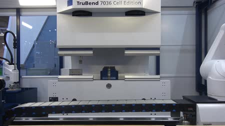 bending : Moscow, Russia - May, 2018: Trubend 7036 Cell Edition automated bending cell machine operated with robot hand Stock Footage