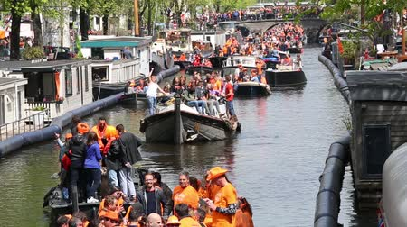 boat tour : Amsterdam, Netherlands - April, 2018: People on the boat celebrate Kings day in Amsterdam city, Netherlands