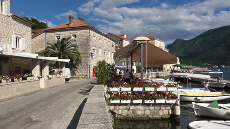 балканский : Perast, Montenegro - June, 2018: Perast city in Boka Kotor Bay in Montenegro Стоковые видеозаписи