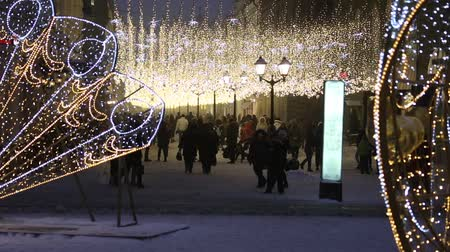 Moscow, Russia - December, 2017: Crowd of people walking on Nikolskaya street decorated for New Year and christmas with light glowing garlands