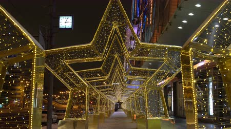 Moscow, Russia - December, 2017: 4K footage of light star glowing tunnel on the street of Moscow, New Year and christmas decoration of the city