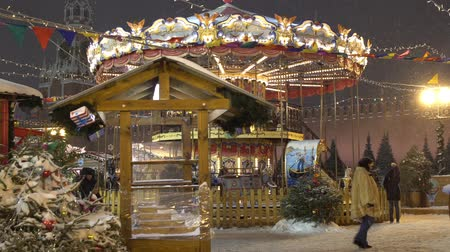 targi : Moscow, Russia - January, 2018: Carousel at the Christmas fair in Moscow city Wideo