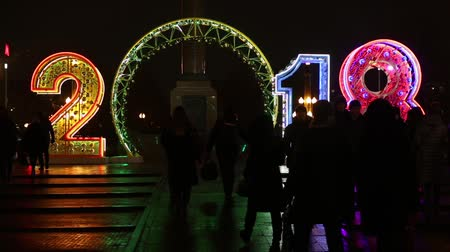 yazılı : Moscow, Russia - January, 2018: New year and christmas Moscow city decoration with 2018 letters glowing sign