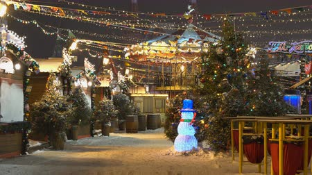 Moscow, Russia - December, 2017: 4K footage of christmas market fair with carousel in Moscow, Russia