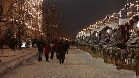 Moscow, Russia - January, 2018: Snowing on christmas market fair in Moscow, Russia