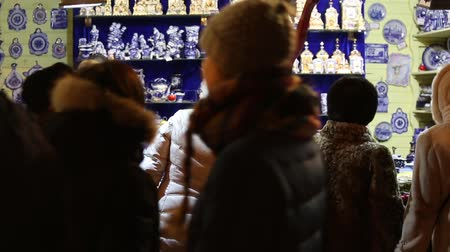 Moscow, Russia - January, 2018: People buying souvenirs on Christmas market fair in Moscow, Russia