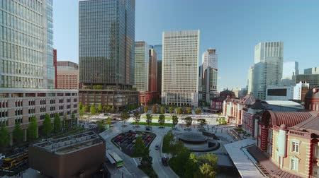 Tokyo, Japan - August 17, 2018: High angle view of Marunouchi side of Tokyo railway station in Chiyoda City, Tokyo, Japan. Стоковые видеозаписи