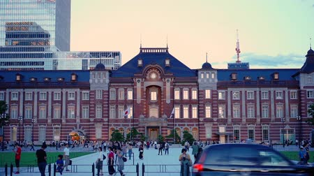 Tokyo, Japan - August 17, 2018: Timelapse video of sunset on the Marunouchi side of Tokyo railway station in Chiyoda City, Tokyo, Japan.