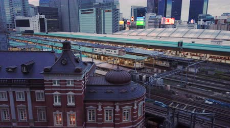 docked : Tokyo, Japan? October 06 2019: Video of high speed Japanese Shinkansen E7 and N777 trains docked in Tokyo railway station in the Chiyoda City, Tokyo, Japan. Stock Footage