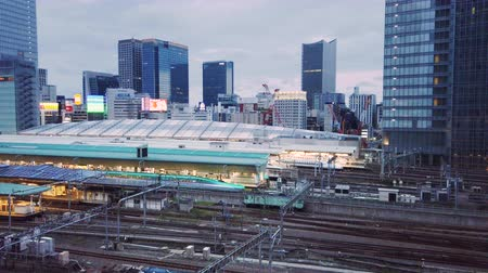 docked : Video of high speed Japanese Shinkansen E7 and N777 trains docked in Tokyo railway station in the Chiyoda City, Tokyo, Japan.