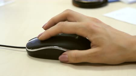 roll up : Female hand using a computer mouse Stock Footage