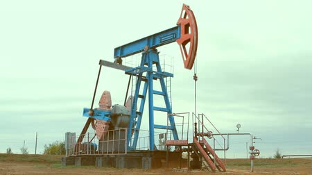 gas : Oil and gas industry. Work of oil pump jack on a oil field. Stock Footage