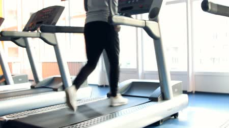 eğitici : People at the gym exercising. Run on a machine. Out of focus Stok Video