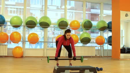 eğitici : Young woman doing exercise with barbell Stok Video