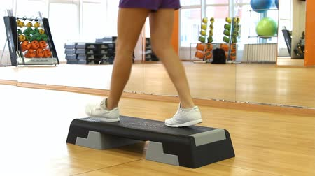 step : Beautifull female legs on the step board during exercise