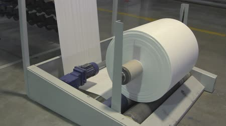 unreel : Big paper roll unreel for a printing press Stock Footage