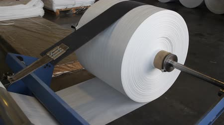 unreel : Big polymeric tape roll unreel for a printing press
