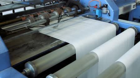 sheet : Big polymeric tape roll unreel for a printing press