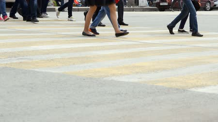step : People cross the road at a pedestrian crossing. City life Stock Footage