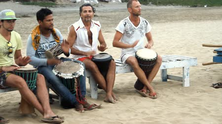 frick : Goa India  February 28 2015: Unidentified man playing on drum at the beach. Goa state Arambol beach. Stock Footage