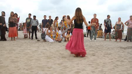 frick : Goa India  February 28 2015: Unidentified people dancing on the beach. Goa state Arambol beach. Stock Footage