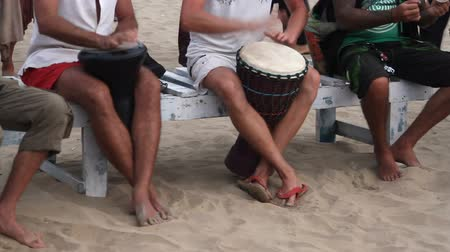 frick : Unidentified man playing on drum at the beach. Goa state Arambol beach. Stock Footage