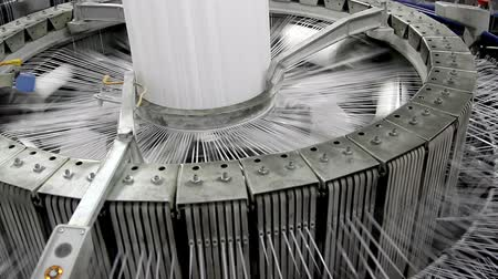 maquinaria : Textile industry - yarn spools on spinning machine in a factory