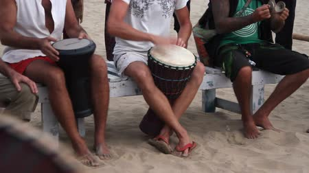 enstrümanlar : Goa, India  February 28, 2015: Unidentified man playing on drum at the beach. Goa state Arambol beach. Stok Video