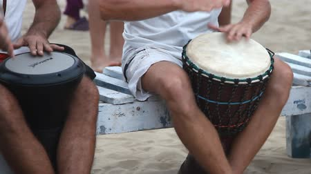frick : Goa, India - February 28, 2015: Unidentified man playing on drum at the Arambol beach.