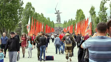 mamaev : Volgograd, Russian Federation - May, 09, 2015: People crowd rises on Mamayev Kurgan Stock Footage